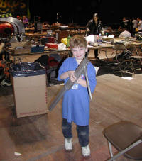 "My son Hal and one of the steel spikes from ""No Apologies."""